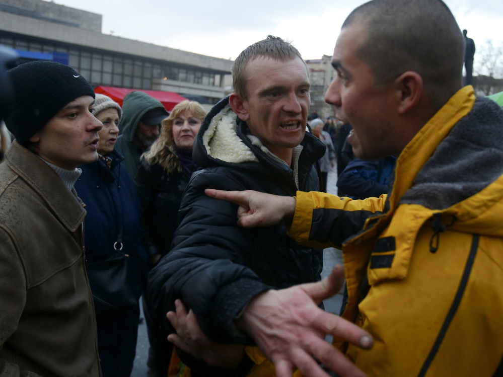 Residents debate at a central square in Simferopol, Crimea, Ukraine. Today most Crimeans see themselves as only nominally Ukrainian and Russian is, by far, the dominant language.
