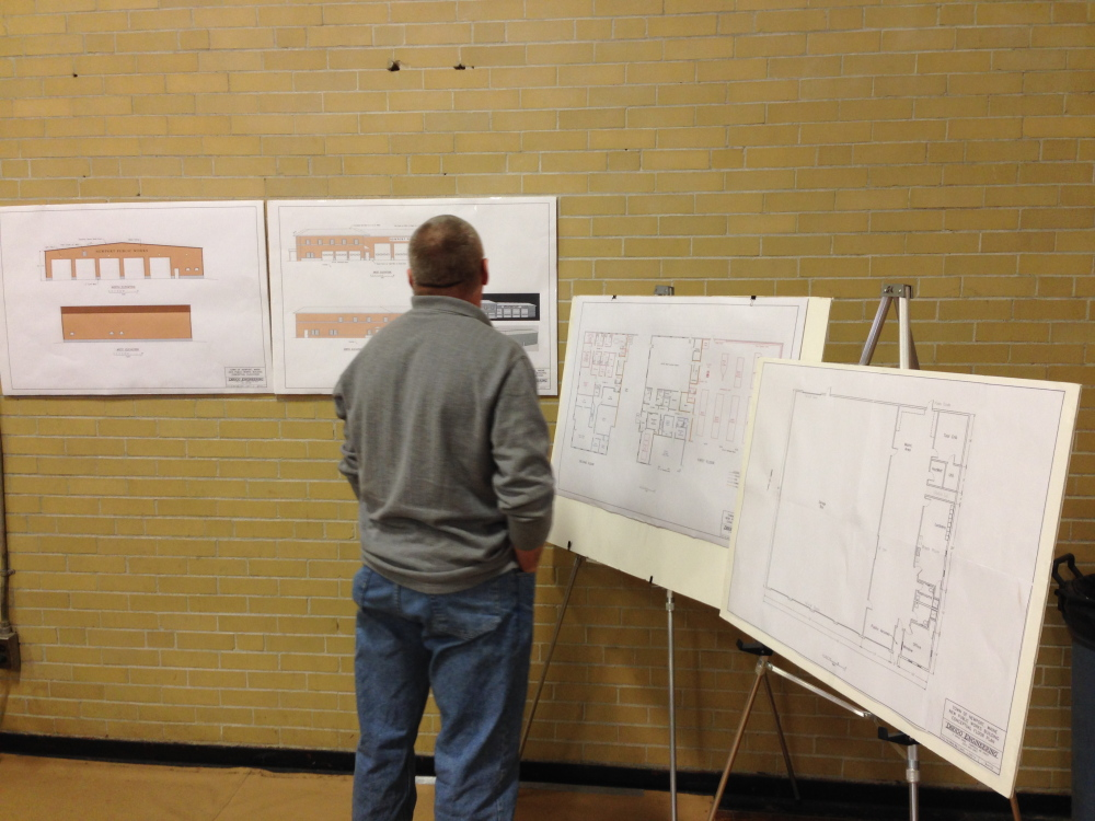 A Newport resident looks over conceptual drawings from Dirigo Engineering of Fairfield of the proposed public works garage and public safety building. Both projects totaling $4.75 million were approved by voters.