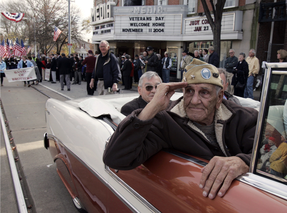 """This Nov. 11, 2004 file photo shows William """"Wild Bill"""" Guarnere participating in the Veterans Day parade in Media, Pa."""