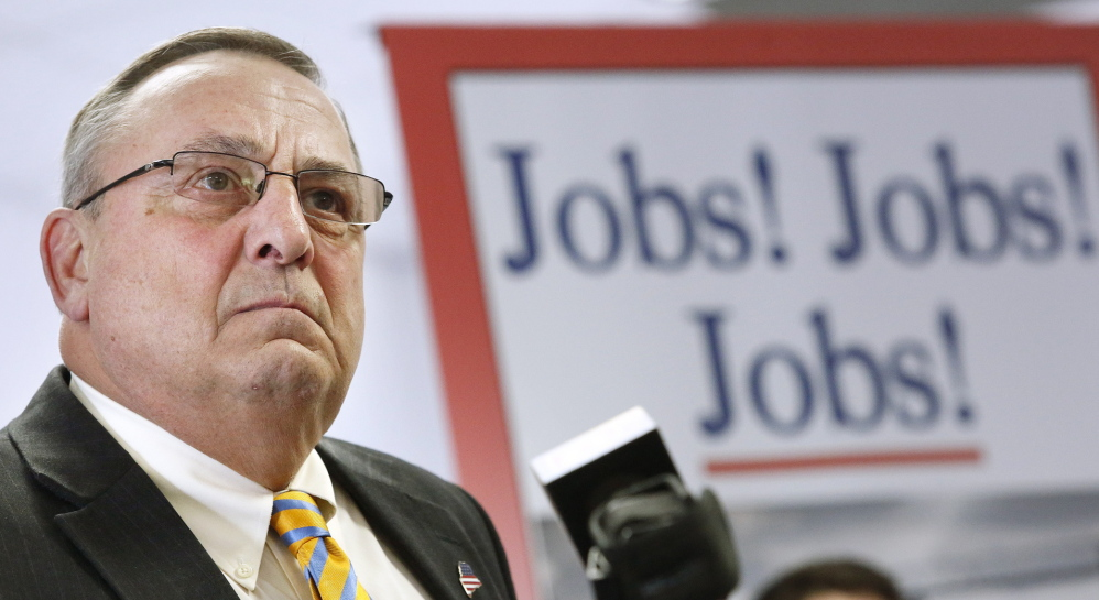 "With a backdrop proclaiming his mission, Gov. Paul LePage holds a news conference Monday to roll out his proposed ""Open for Business Zones"" inside the Maine Technology Institute at Brunswick Landing."