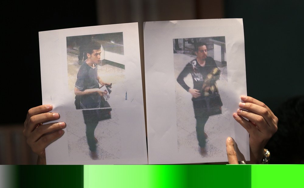 Pictures of the two men, a 19-year old Iranian, identified by Malaysian police as Pouria Nour Mohammad Mehrdad, left, and Delavar Seyedmohammaderza, 29, who boarded the now missing Malaysia Airlines jet MH370 with stolen passports.