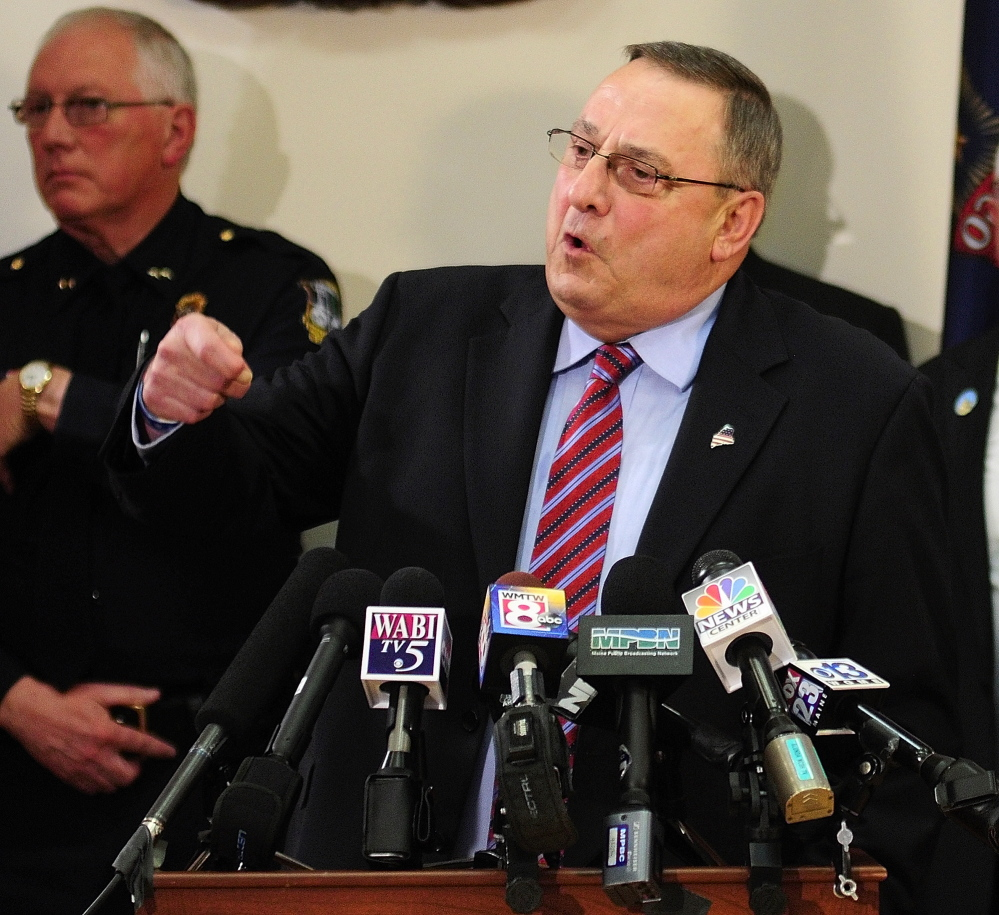 Gov. Paul LePage answers questions during a news conference Tuesday about his plan to crack down on drug dealing and abuse.