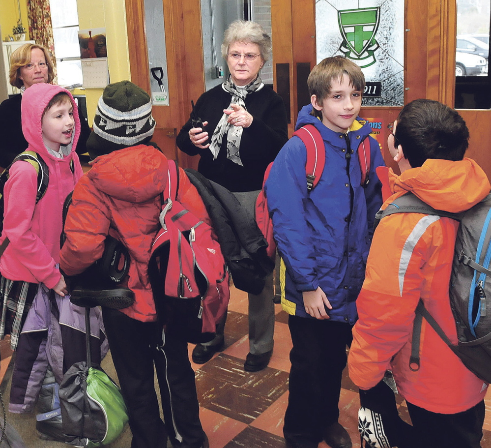 GROWING SCHOOL: Mount Merici Academy Principal Susan Cote directs students leaving during an early-release day Wednesday at the Waterville private school.