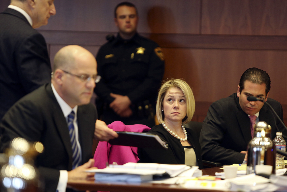 Bridget Kelly, New Jersey Gov. Chris Christie's former deputy chief of staff, looks at her attorney Michael Critchley, left, during a hearing Tuesday in Trenton, N.J. Attorneys for Kelly and Bill Stepien, the other ex-Christie loyalist fighting a subpoena, were in court to try to persuade a judge not to force them to turn over text messages and other private communications to New Jersey legislators investigating the political payback scandal ensnaring Christie's administration.