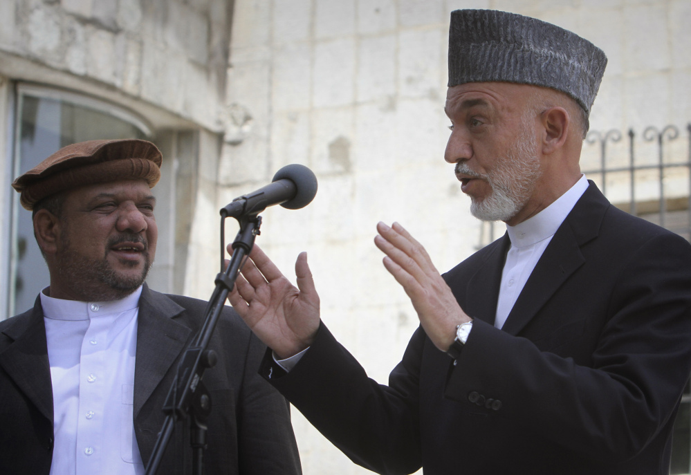 Afghan President Hamid Karzai, right, who came into power in December 2001, will be replaced in the April 5 elections. Under Afghanistan's constitution, Karzai is banned from seeking a third term.