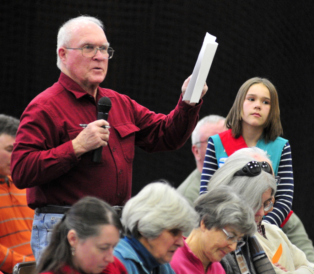 A Voter inquires: Dennis Purington asks a question Saturday during the 2014 Belgrade Town Meeting at the Center For All Seasons.