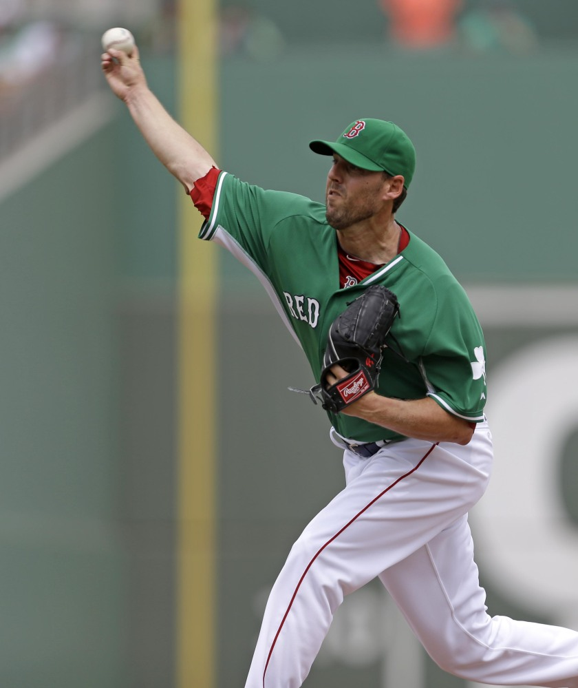 AND The PITCH: Boston Red Sox starting pitcher John Lackey pitches in the first inning Monday of an exhibition game against the St. Louis Cardinals in Fort Myers, Fla. The Red Sox won 10-5.