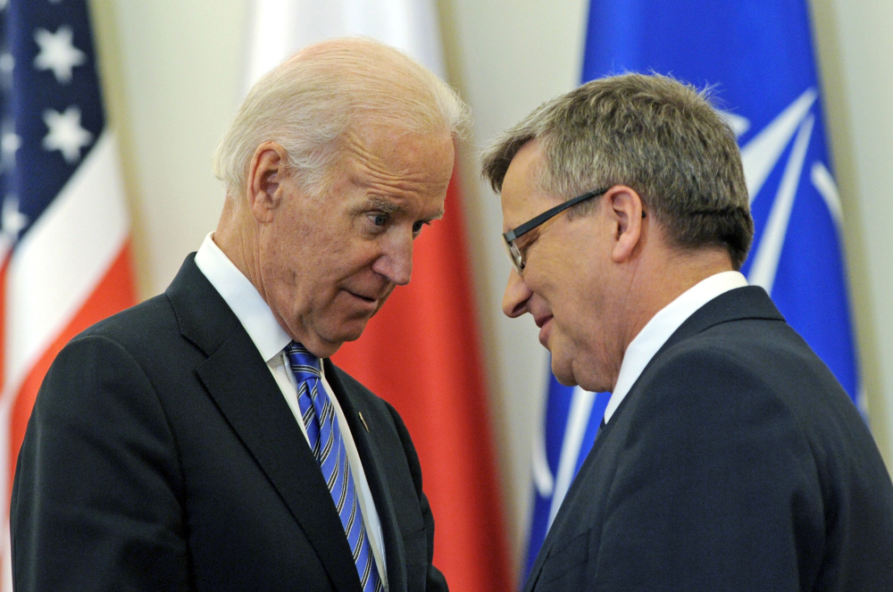 U.S. Vice President Joe Biden and Polish President Bronislaw Komorowski talk after a press conference in Warsaw, Poland, Tuesday. Biden arrived in Warsaw for consultations with Komorowski and Prime Minister Donald Tusk a few hours after Russian President Vladimir Putin approved a draft bill for the annexation of Crimea, one of a flurry of steps to formally take over the Black Sea peninsula.