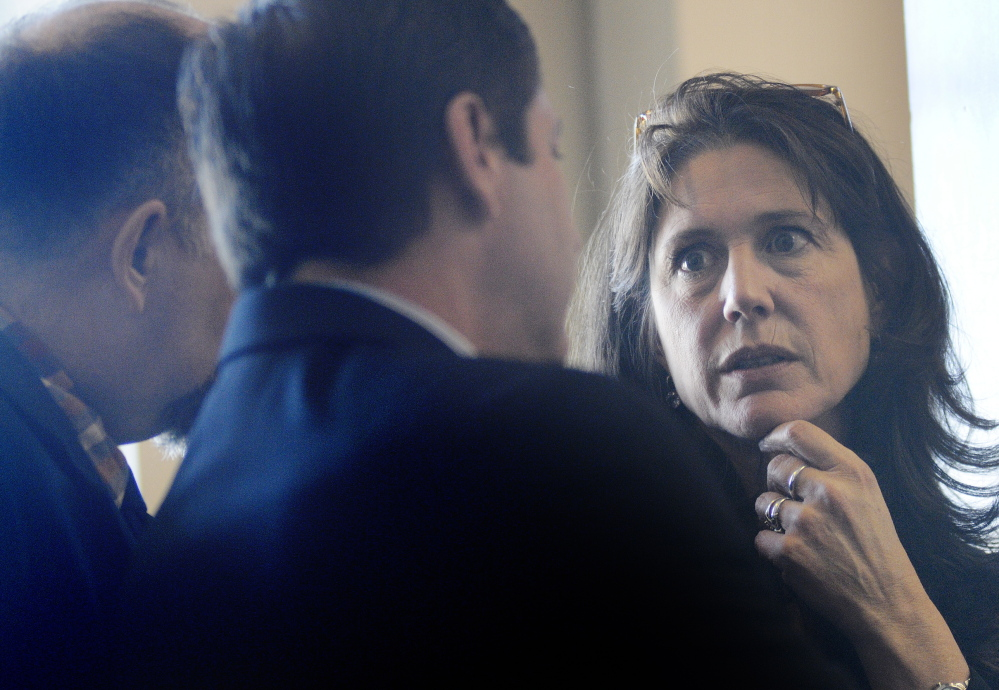 Rep. Deborah Sanderson, R-Chelsea, right, confers Tuesday with minority leader Ken Fredette, R-Newport, center, and Rep. Lance Harvell, R-Farmington, during a debate in the House of Representatives about a measure to expand Medicaid in Maine.