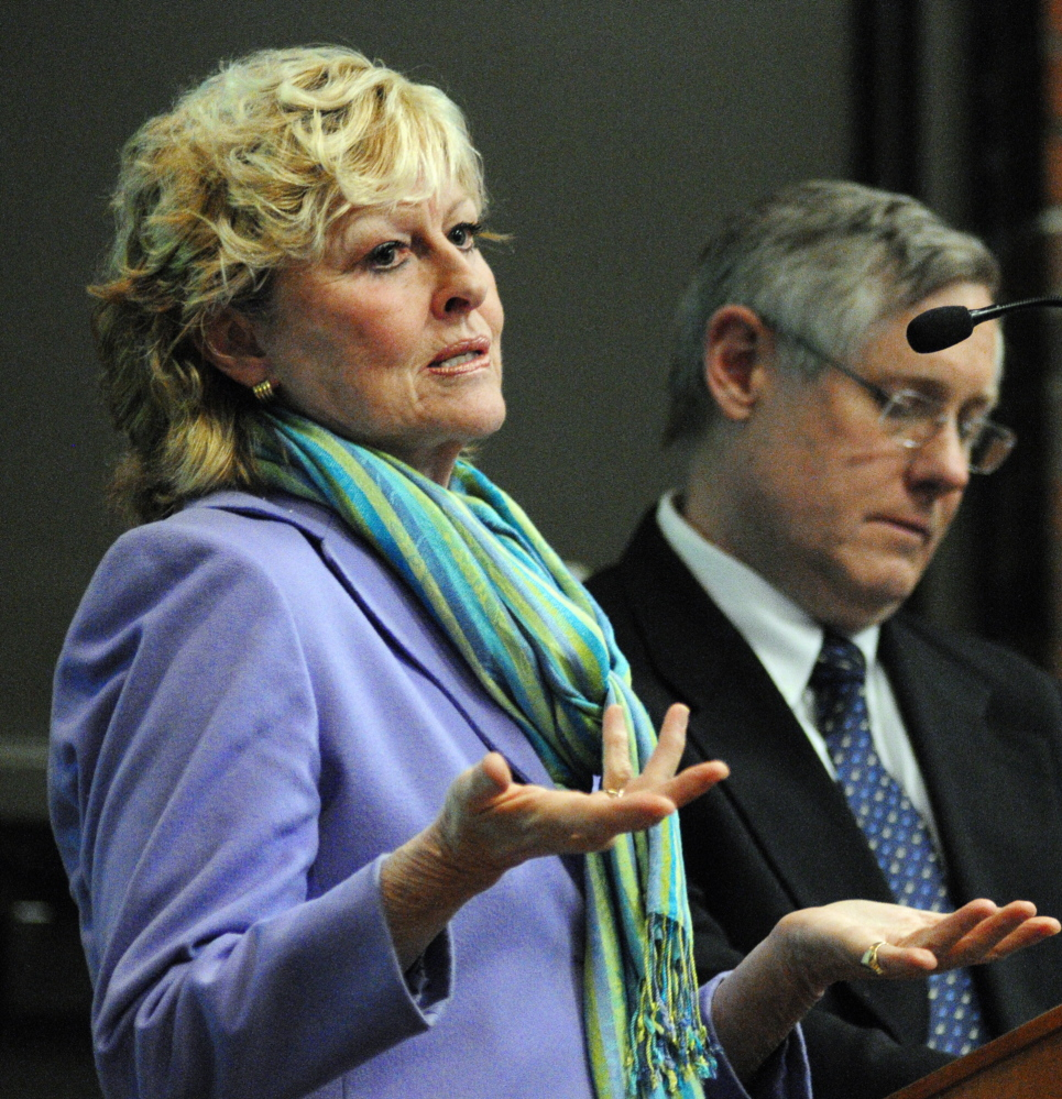 UMA Cuts: Allyson Handley, university president, left and Tim Brokaw, vice president of finance and administration, take questions from the audience on proposed budget cuts during a meeting on Wednesday in Jewett Hall at the University of Maine at Augusta.
