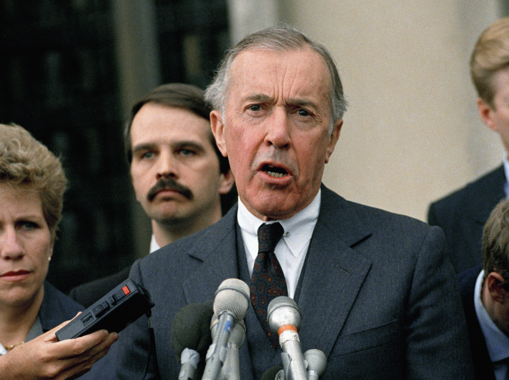 Lawrence Walsh, then the Iran-Contra special prosecutor, speaks to reporters outside U.S. District Court in Washington in 1989. Walsh charged 14 people with criminal offenses during the investigation, mostly for lying or withholding information from Congress. Eleven pleaded guilty or were convicted, though the two most high-profile targets, Oliver North and John Poindexter, had their convictions overturned on appeal.