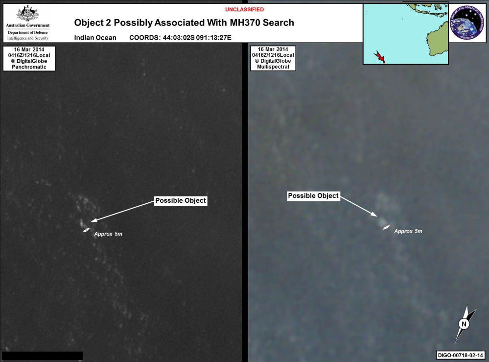 In this satellite imagery provided by Commonwealth of Australia – Department of Defence on Thursday, a floating object is seen at sea next to the descriptor which was added by the source. Australia's government reported Thursday that the images show suspected debris from the missing Malaysia Airlines jetliner floating in an area 1,550 miles southwest of Perth, Australia.
