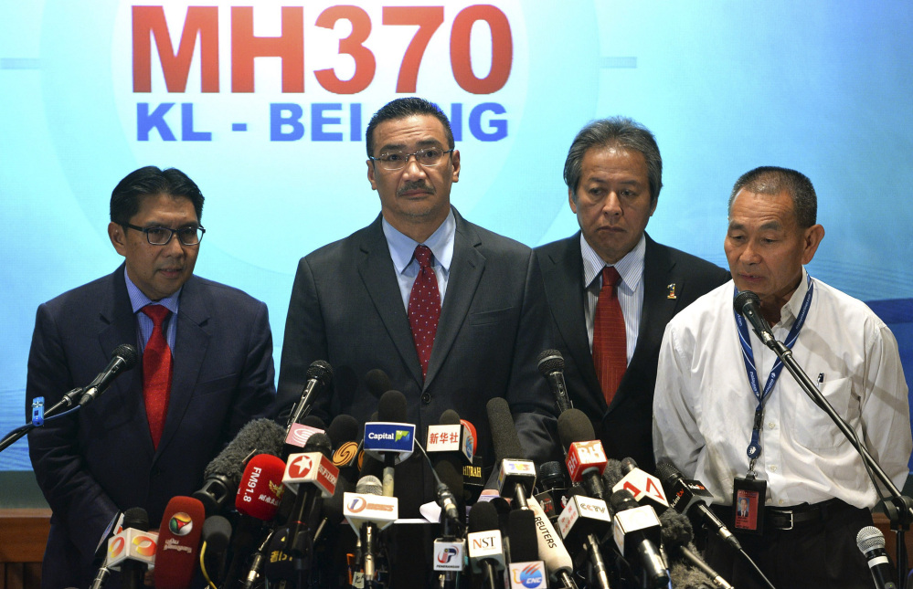 From left, Malaysia's Department of Civil Aviation director general Azharuddin Abdul Rahman, Malaysian acting Transport Minister Hishammuddin Hussein, Malaysian Foreign Minister Anifah Aman and Malaysia Airlines Group Chief Executive Ahmad Jauhari Yahya attend a news conference at a hotel in Sepang, Malaysia, on Thursday.