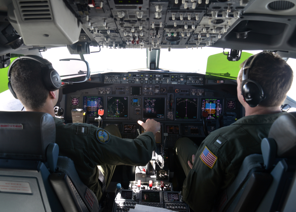 In this photo provided by the U.S. Navy, Lt. j.g. Kyle Atakturk, left, and Lt. j.g. Nicholas Horton pilot a U.S. Navy P-8A Poseidon during a mission to assist in search and rescue operations for Malaysia Airlines flight MH370 on Wednesday. Military planes from Australia, the U.S. and New Zealand have been searching for the plane in a region over the southern Indian Ocean that was narrowed down from 232,000 square miles to 117,000 square miles.