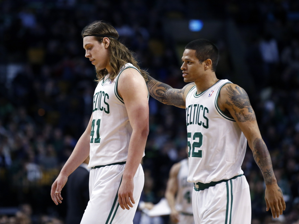 Boston Celtics center Kelly Olynyk, left, and guard Chris Babb walk to the bench during a time out in the fourth quarter of a March 5 game against the Golden State Warriors in Boston. The Warriors won 108-88.