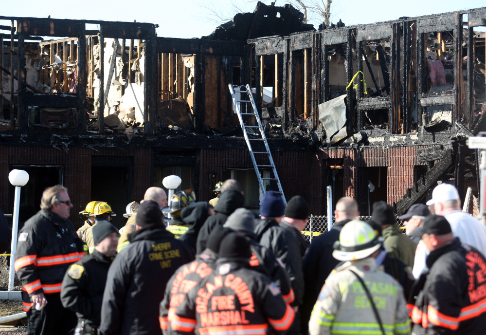 Firefighters investigate an early morning fire at the Mariner's Cove Hotel in Point Pleasant Beach, N.J. on Friday.