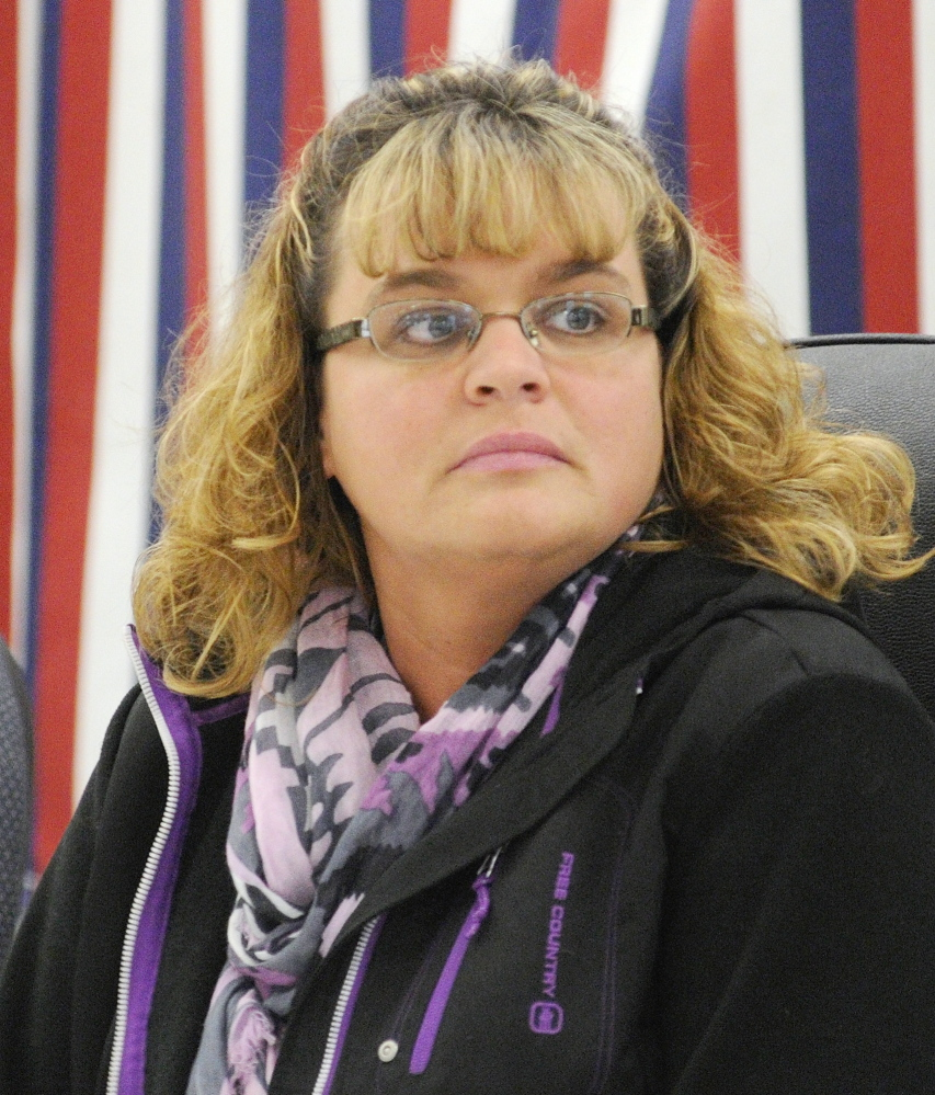 New Clerk: Angela Phillis sits at the head table after she was elected town clerk before the start of the 163rd West Gardiner Town Meeting on Saturday at the West Gardiner Fire Station.