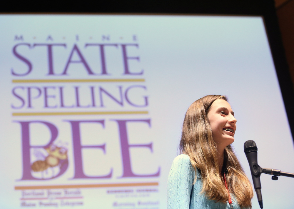 Lucy Tumavicus, 14, of Portland stands at the microphone Saturday during an exceptionally long Maine State Spelling Bee. As champ, she'll go on to the national competition in May.