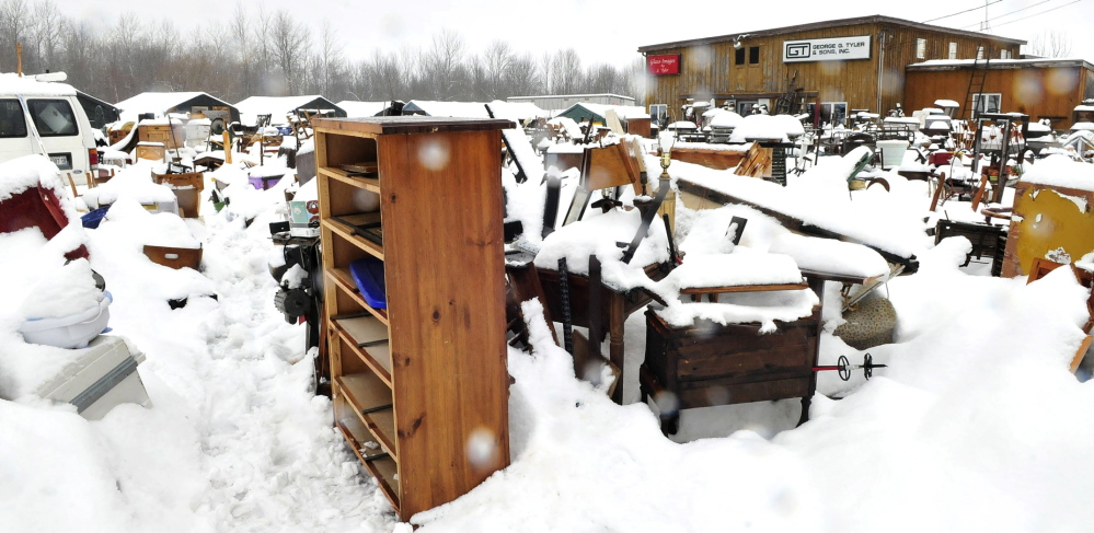 STUFF: Household items and equipment are covered in snow at the 201 Antiques business in Fairfield on Thursday. The town of Fairfield has ordered owner Robert Dale to clean up the site and pay more than $9,000 in legal fees.