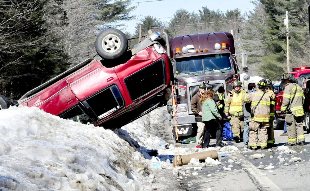 ROLLED: Fairfield police and firefighters responded to an accident that left an SUV upside down on a snowbank along Route 139 in Fairfield Center on Monday.