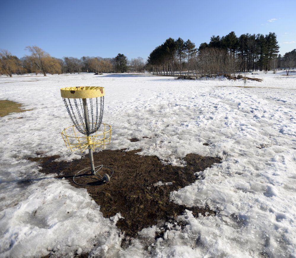 "Pleasant Hill Disc Golf in Scarborough was still snow-covered Monday. Owner Kristi Stanley says she doesn't know when it will open. ""I'm tired of guessing,"" she said."
