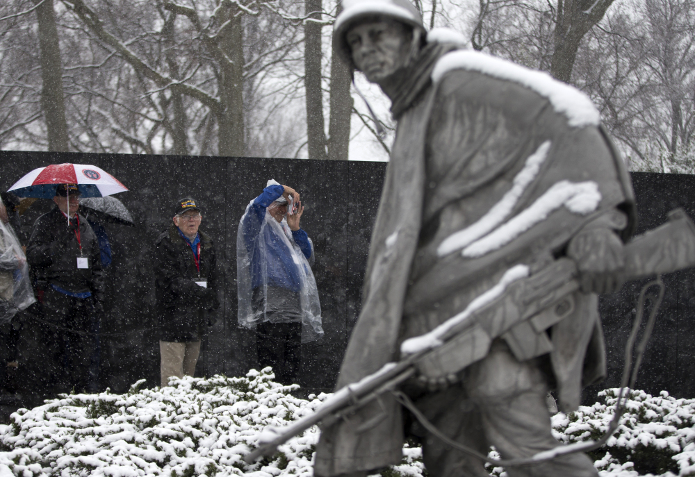Visitors view the Korean War Memorial during a snowstorm in Washington on Tuesday.