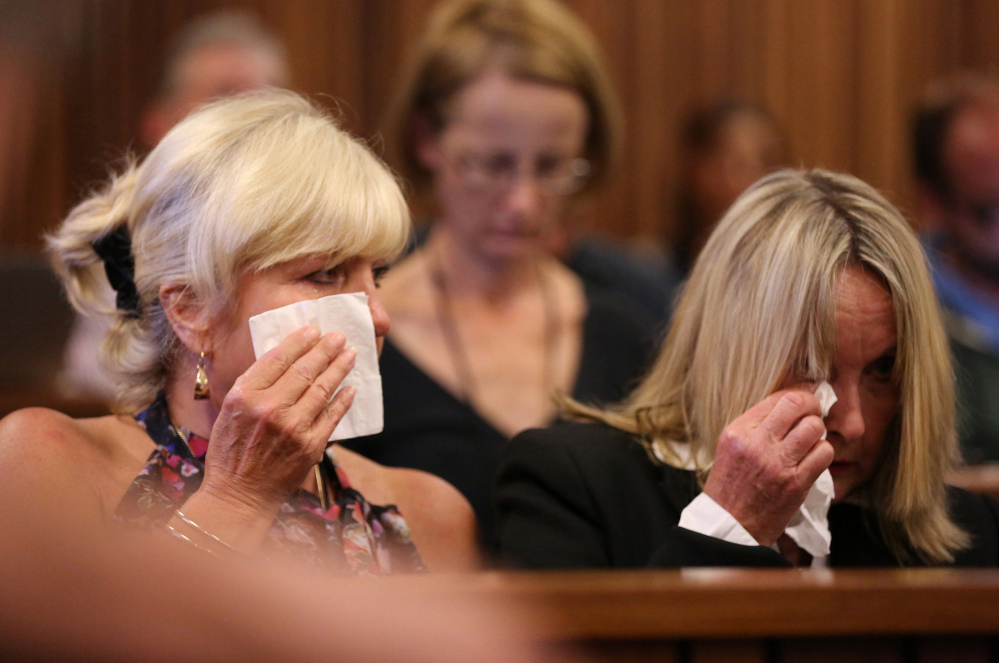 June Steenkamp, right, mother of the late Reeva Steenkamp, and family friend, Jenny Strydom, react during the murder trial of Oscar Pistorius, during cross questioning on mobile phone text messages between Pistorius and Steenkamp.