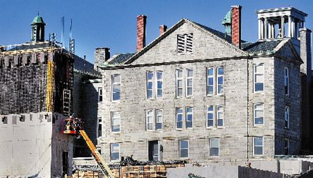 NO JUSTICE: The Kennebec County Courthouse, shown at right in this 2013 file photo, was closed Wednesday afternoon when about 15 gallons of oil leaked from a tank in the basement.