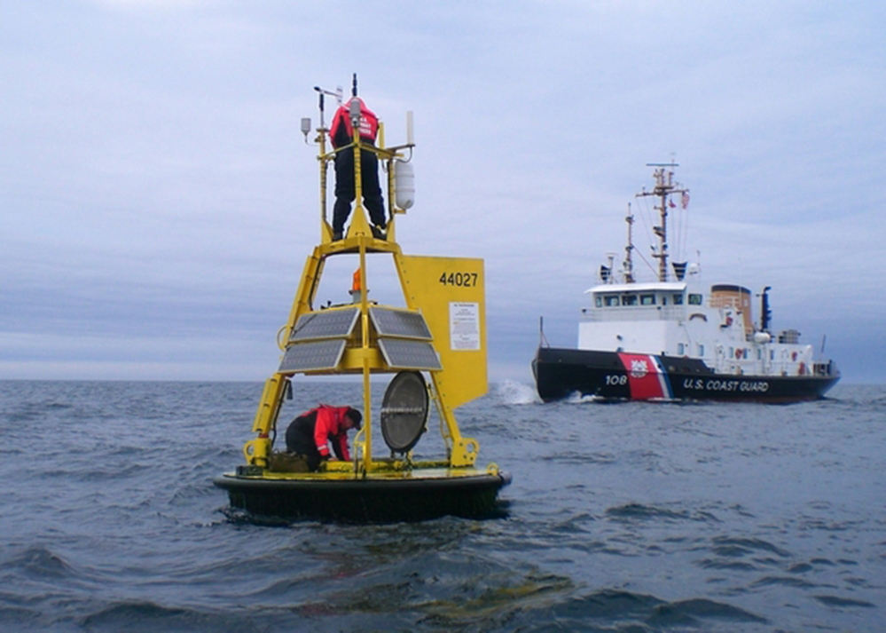 Workers maintain NOAA's Jonesport buoy in this photo from the National Data Buoy Center website.