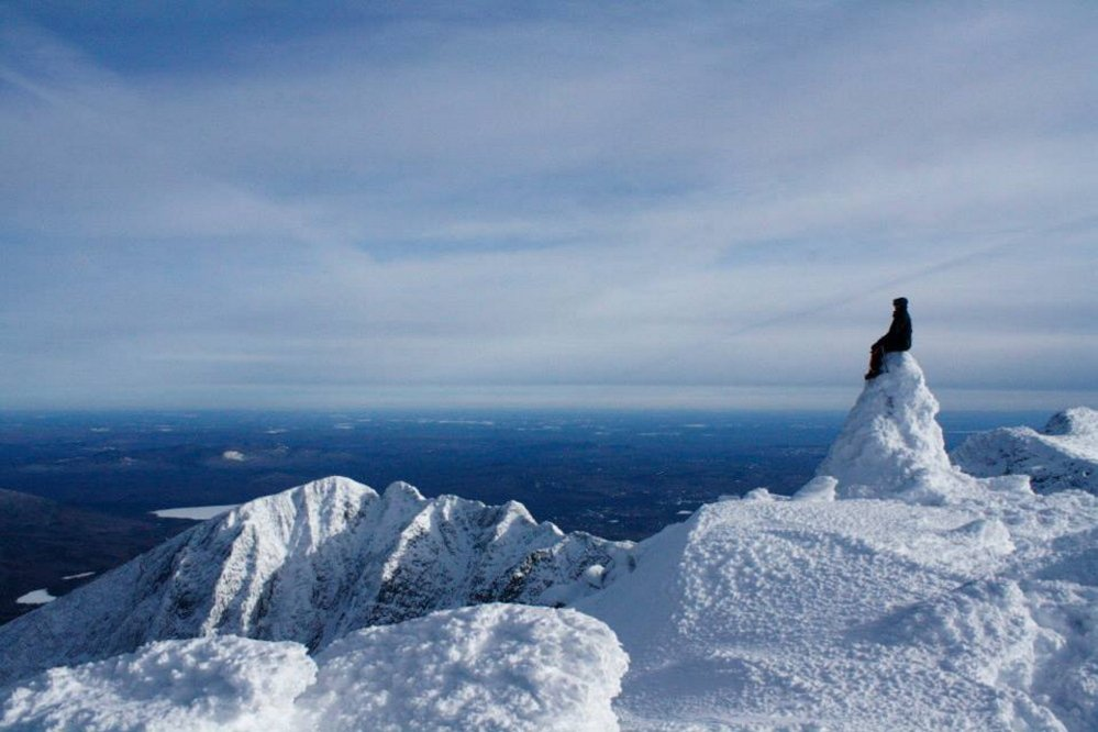 Contributed photos by Bo Willoughby Tyler Heinrich, of Albion, checks out the view surrounding Mt. Katahdin from Baxter Peak. Heinrich and Bo Willoughby, a Winslow native and Belgrade resident, hiked Mount Katahdin in the heart of winter, spending two nights in temperatures that dipped to well below zero.