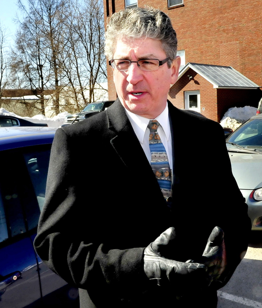HEARING: Deputy Attorney General William Stokes speaks outside Skowhegan District Court on Thursday after a hearing to determine the competence of Kelli Murphy, 12.