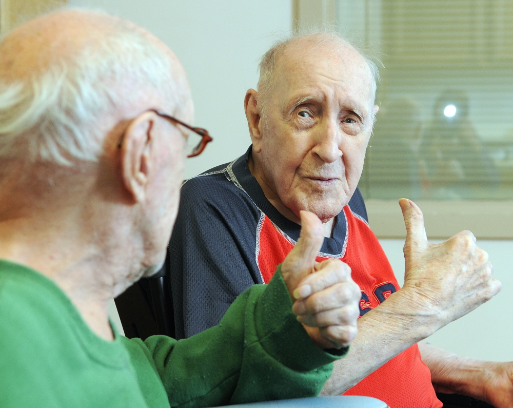 SO FAR, SO GOOD: Twin brothers Lawrence Binette, left, and Maurice Binette give each other a thumbs-up on Thursday at an early 100th birthday party at the Maine Veterans' Home in Augusta.