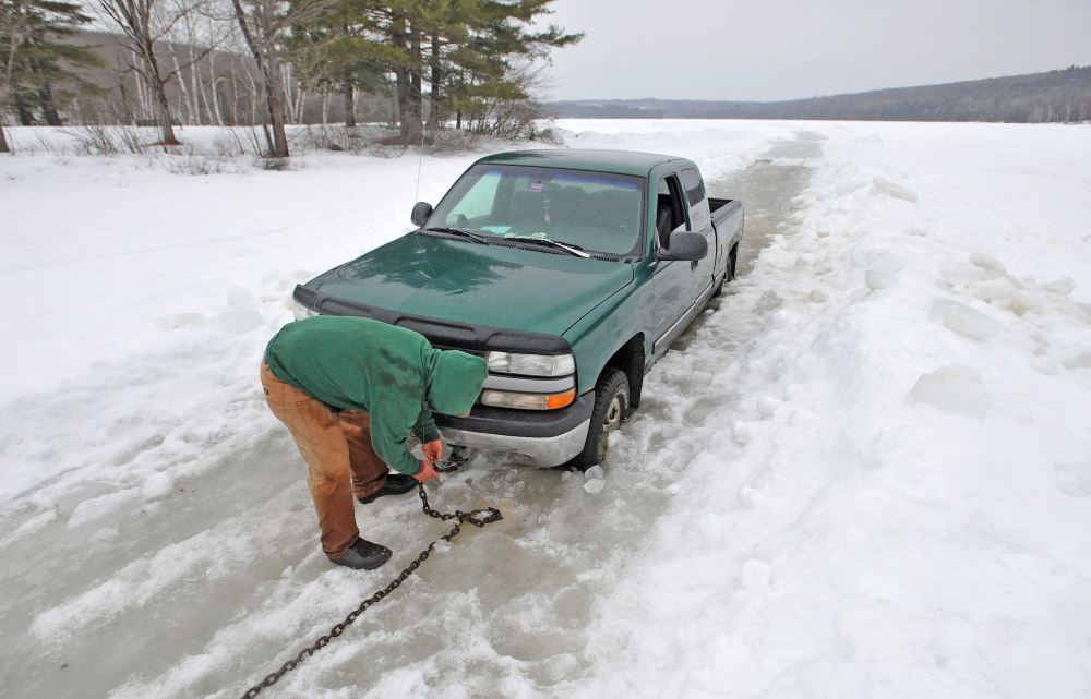 SOFT ICE: Steve Richardson, 28, of Clinton, tries to free his pickup truck Friday from Lake George in Canaan after trying to get his ice fishing shack off the ice ahead of an April 1 deadline. Richardson's truck broke through about 2 feet of ice, coming to rest on another layer of ice and lake water.
