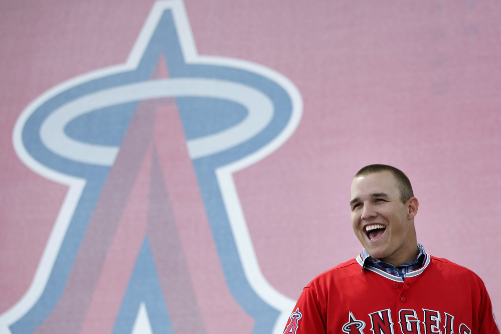 RICH MAN: Los Angeles Angels outfielder Mike Trout laughs during a media gathering held Saturday to announce his six-year contract extension with the Angels at Angel Stadium in Anaheim, Calif. Trout and the Angels agreed Friday night to a $144.5 million, six-year contract, keeping the young star under club control through 2020.