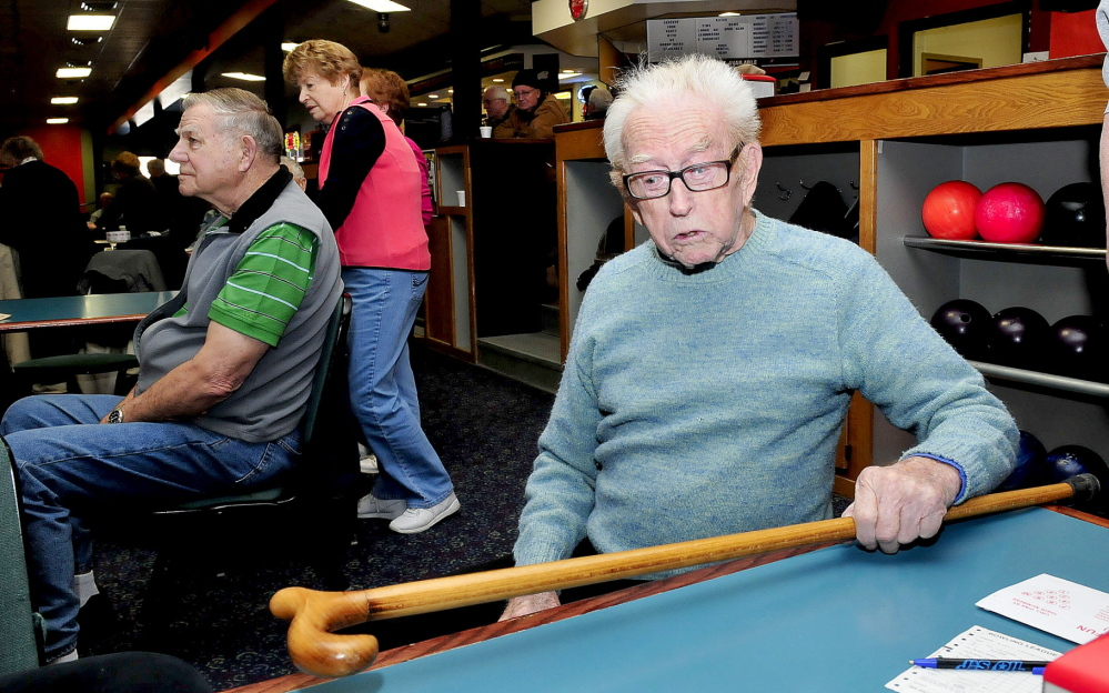 Staff photo by David Leaming NEVER TOO OLD: Red Ryer, 98, still uses a cane to walk but has no problem actively bowling in a seniors league at the Sparetime Bowling center in Waterville.