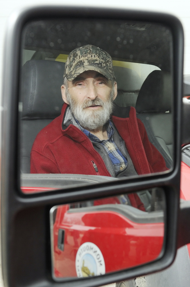 GRATEFUL: Leonard Crocker, sitting in a Monmouth Public Works truck on Friday at the town garage, said he would like to find the woman who apparently helped save his life March 17 in Monmouth after he had a heart attack and collapsed on a road while working.