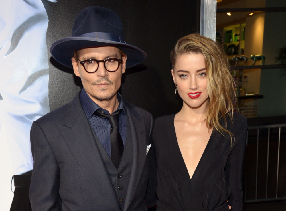 Johnny Depp and Amber Heard are shown together in February. Depp on Monday indirectly confirmed rumors of his engagement to actress Amber Heard.