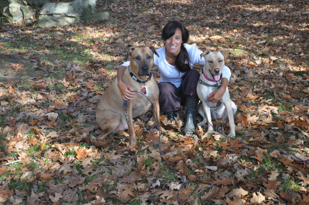 IN HER HONOR: Amy Buxton, who died last year at age 26, loved her dogs Melina and Ollie and would have wanted to volunteer at the pet food pantry that will open in her memory.