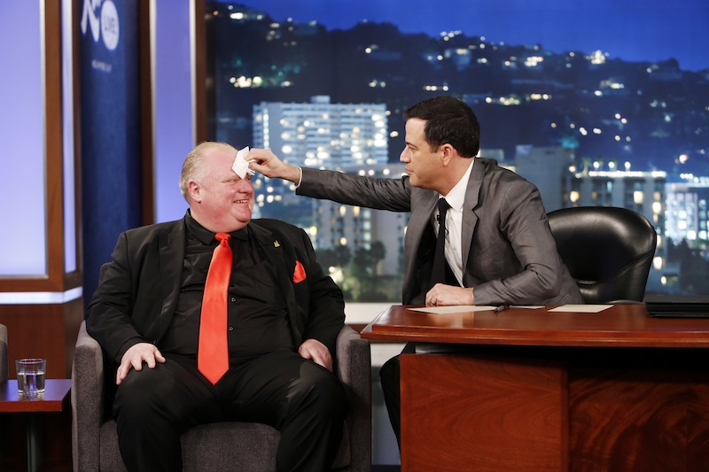 This March 3, 2014 image released by ABC shows Toronto Mayor Rob Ford, left, having his forehead wiped by host Jimmy Kimmel on the late night talk show