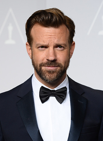 Jason Sudeikis poses in the press room during the Oscars on March 2, 2014, in Los Angeles.