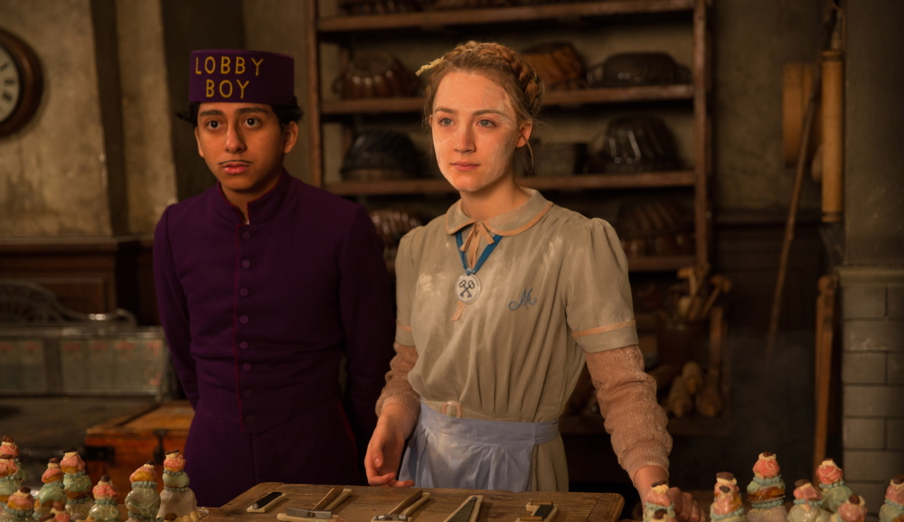 This image released by Fox Searchlight shows Tony Revolori, left, and Saoirse Ronan in