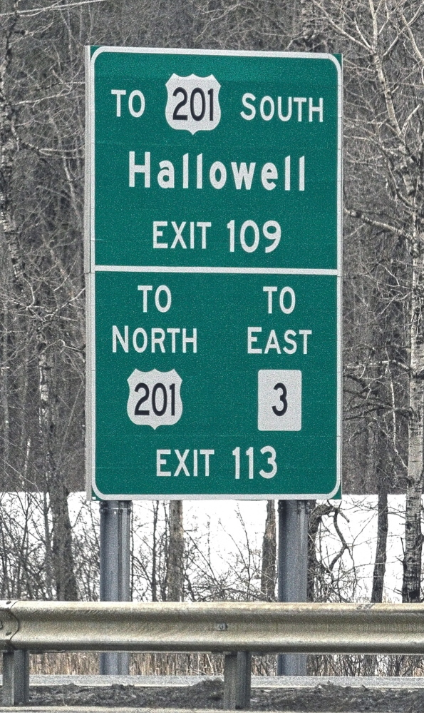 Staff photo by Joe Phelan SIGN LANGUAGE: Signs such as these that direct drivers to smaller cities and towns would be taken down under a proposal from the Maine Department of Transportation and Maine Turnpike Authority.