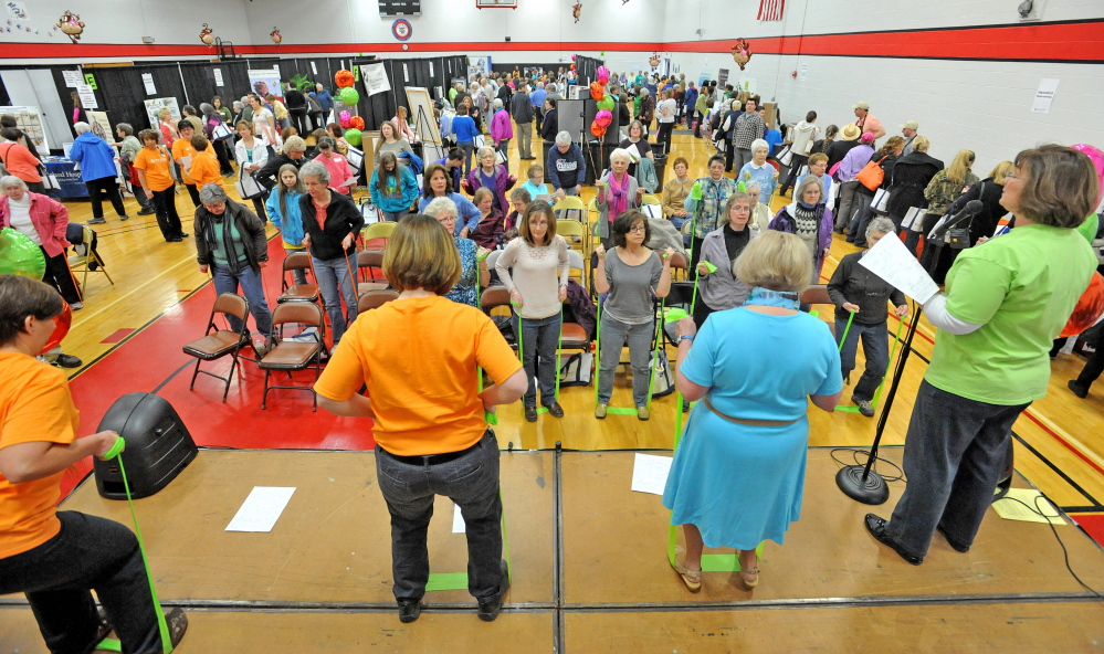 That's a stretch: Women watch and participate in a free elastic band exercise demonstration Saturday at the 17th annual World of Women's Wellness, sponsored by Inland Hospital at Thomas College.