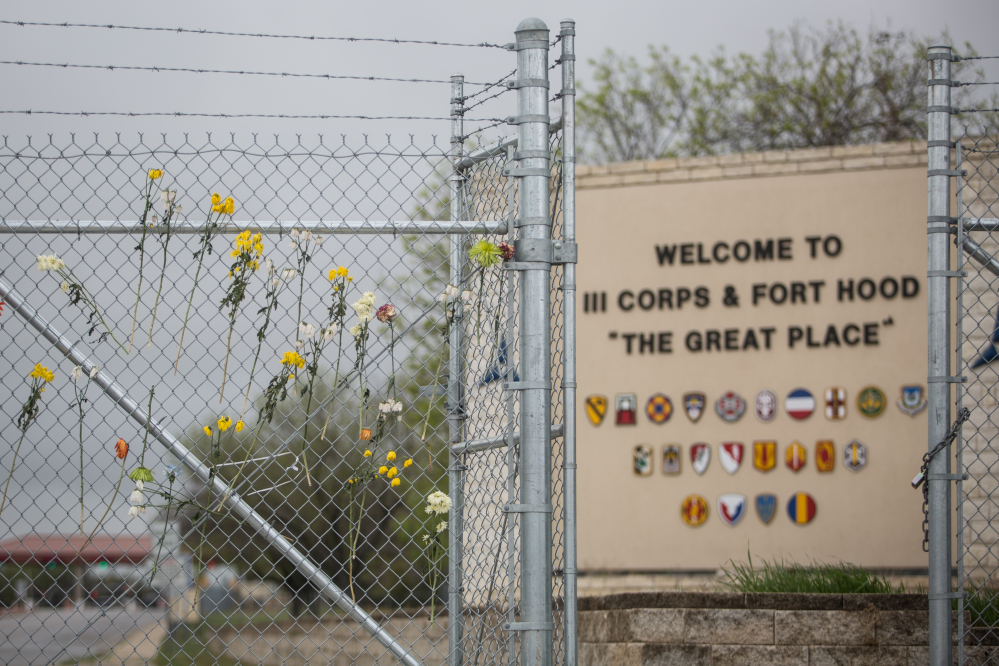 Flowers adorn a fence outside of Fort Hood's east gate on Sunday in Killeen, Texas, in honor of those killed and wounded in the Fort Hood shooting on April 2.