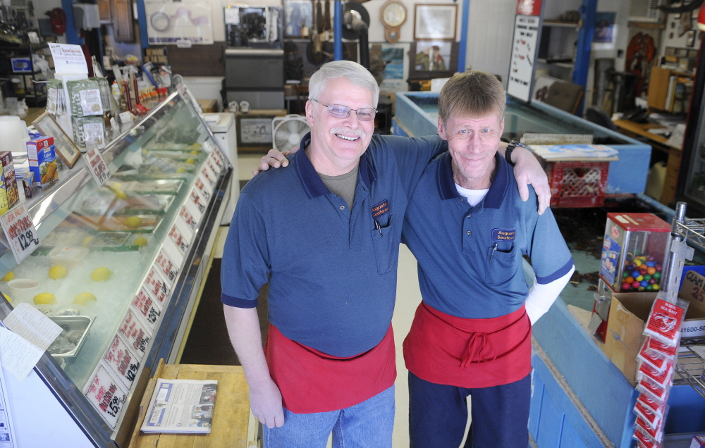 GONE FISHIN': Robert Benedict, left, and his brother, Jeff, are retiring rom the business, Augusta Seafood, that their family has operated in Augusta since the 1970s, and have put it up for sale.