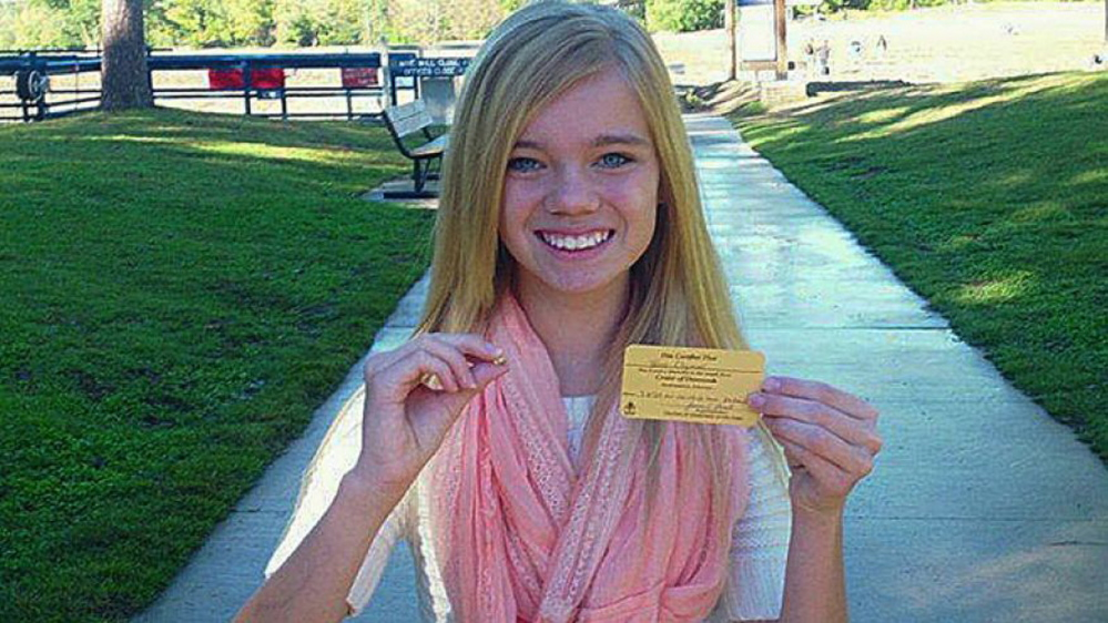 This photo provided by Crater of Diamonds State Park shows Tana Clymer, 14, of Oklahoma City, with a 3.85-carat canary diamond she discovered Oct. 19, 2013. The park is the only diamond-producing site in the United States that is open to the public.