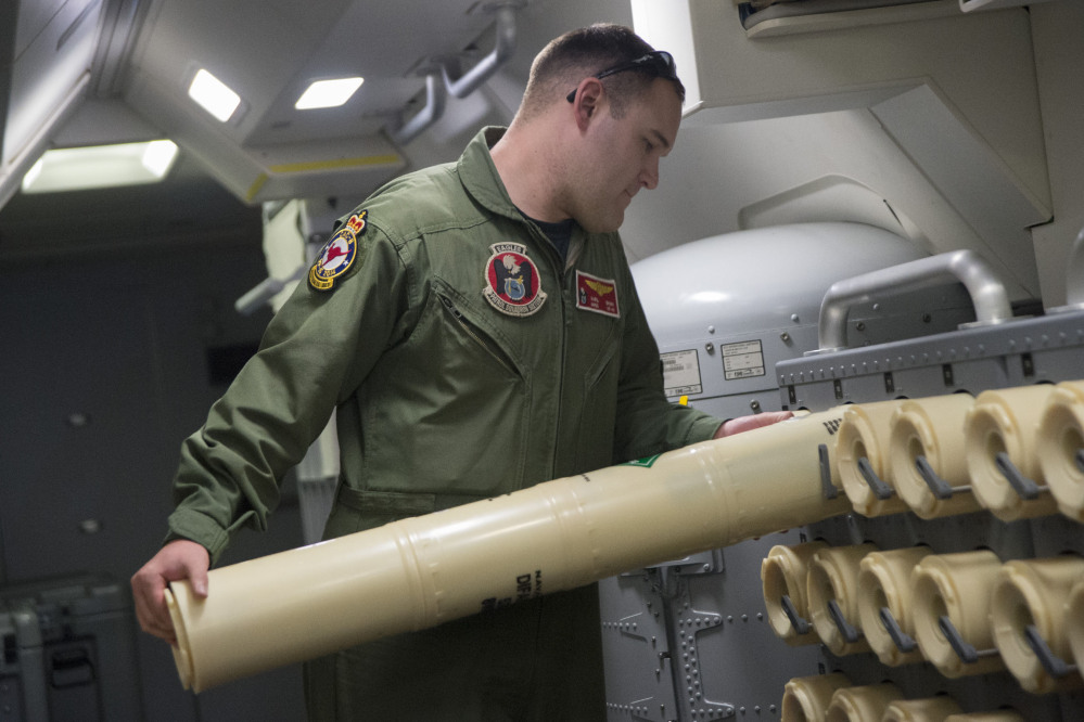 The Associated Press/U.S. Navy Airman 2nd Class Karl Shinn unloads a sonobuoy from a rack onboard a P-8A Poseidon aircraft during a search mission looking for missing Malaysia Airlines flight MH370 over the southern Indian Ocean, in a photo released Thursday. Sonobuoys are used to detect frequencies and signals in the water.