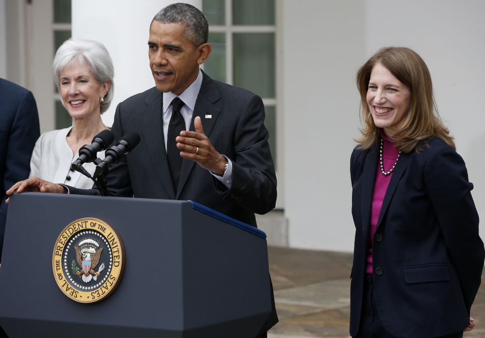 President Barack Obama stands with outgoing Health and Human Services Secretary Kathleen Sebelius, left, and his nominee to be her replacement, Budget Director Sylvia Mathews Burwell in the Rose Garden of the White House Friday.