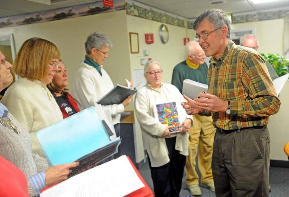 Soothe Souls: Harry Vayo, head of the Tourmaline Singers, directs the choir during a performance at the Augusta Center for Health and Rehabilitation.