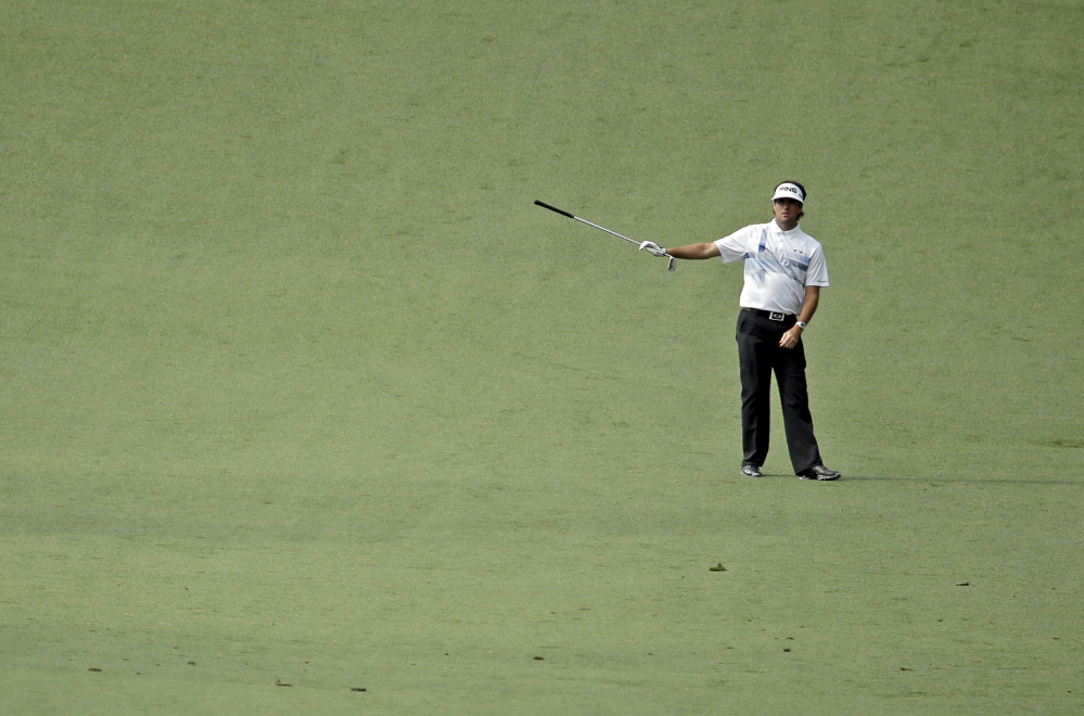 Bubba Watson points to his approach shot on the 10th hole during the fourth round of the Masters on Sunday.